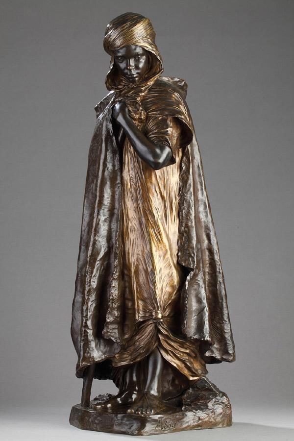 """Marius-Joseph Saïn (1877-1961), """"Aïn-Regada, jeune berger arabe"""", bronze à triple patines, fonte Jollet et Cie, haut. 65 cm, sculptures - galerie Tourbillon, Paris"""