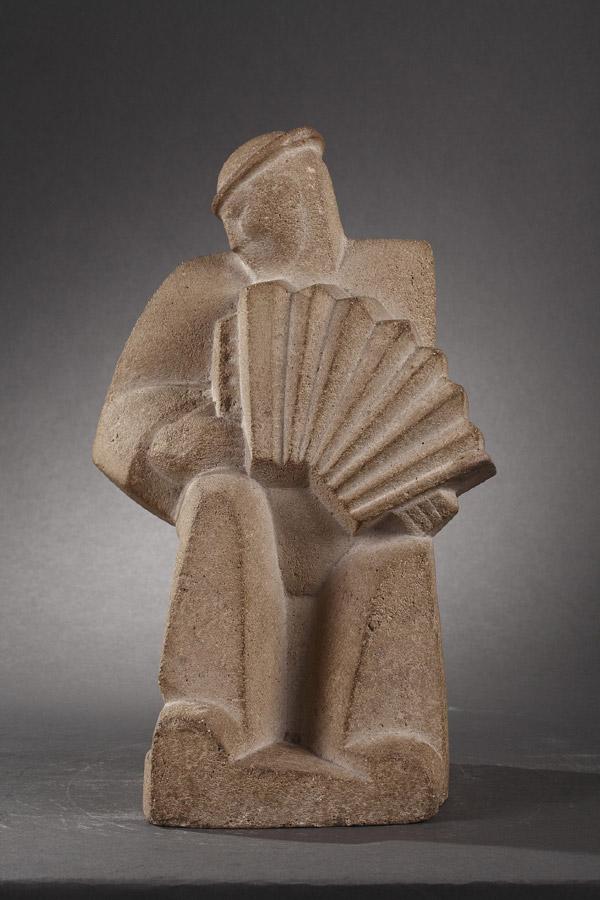 """Jan et Joël Martel (1896-1966), """"Le Joueur d'accordéon"""", ciment-pierre reconstituée, haut. 32,2 cm, sculptures - galerie Tourbillon, Paris"""